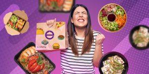 Na zdjęciu widać dziewczynę trzymającą papierową torbę z jedzeniem na tle grafiki firmy e-catering.
